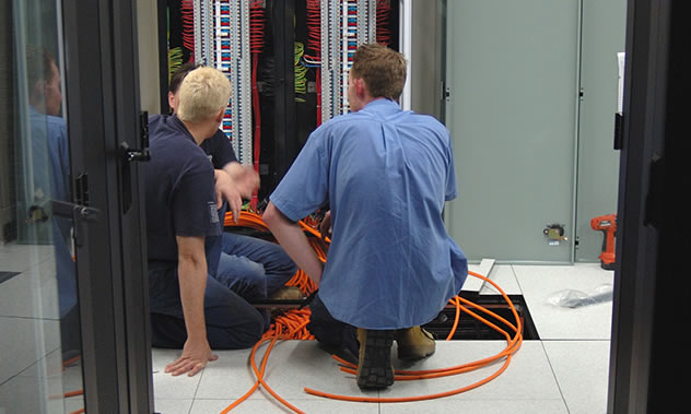 Data Center Professionals Working on a Server Rack