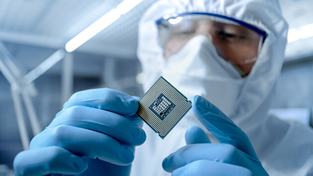 man-in-manufacturing-labsuit-with-s-semiconductor